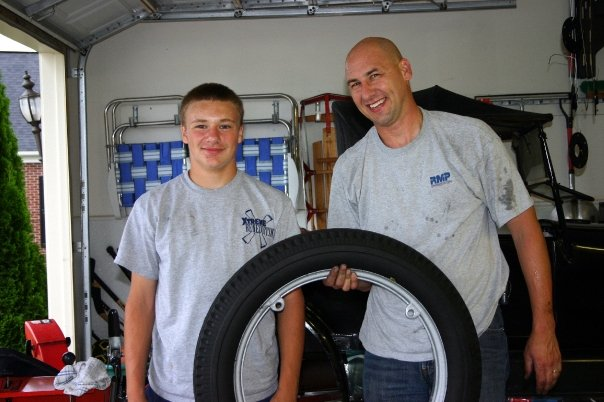 My son and I putting new tires on the 27