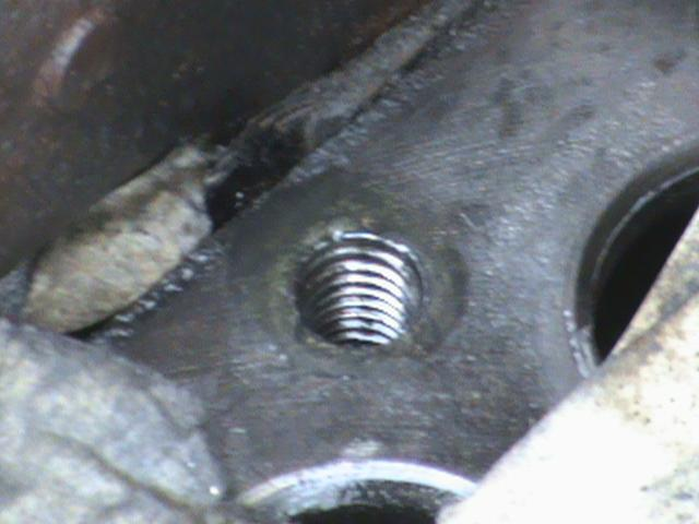 broken end of head bolt on tap