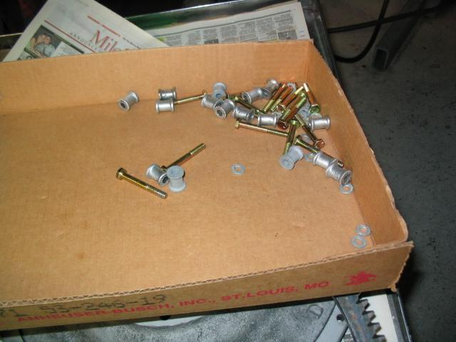 "I use 1/4 inch coarse, X 2""  bolts, and tap the flywheel."