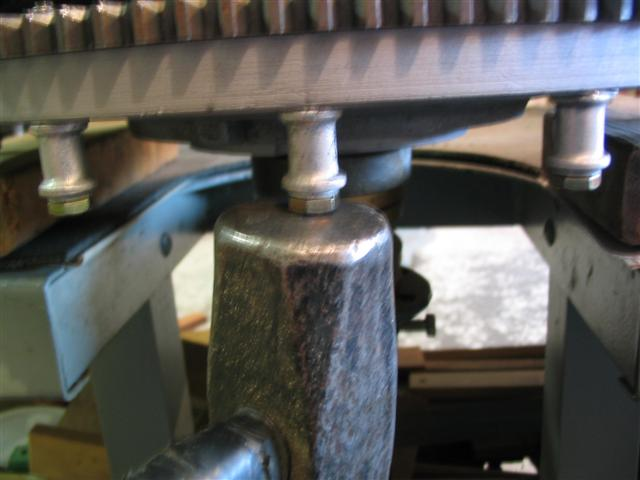 I hold a big hammer under the bolt to take the stress of the threads when peening.