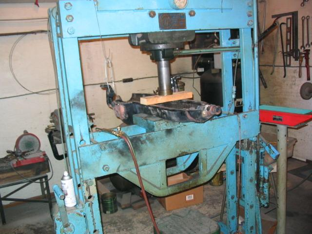 The Pan is held in a 75 ton Wilson press so I can file the front end Babbitt, and chip at the Brazing flux.