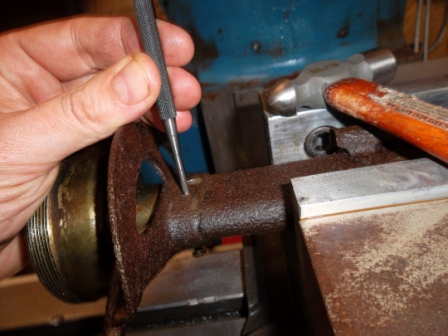 Punching out old rivet
