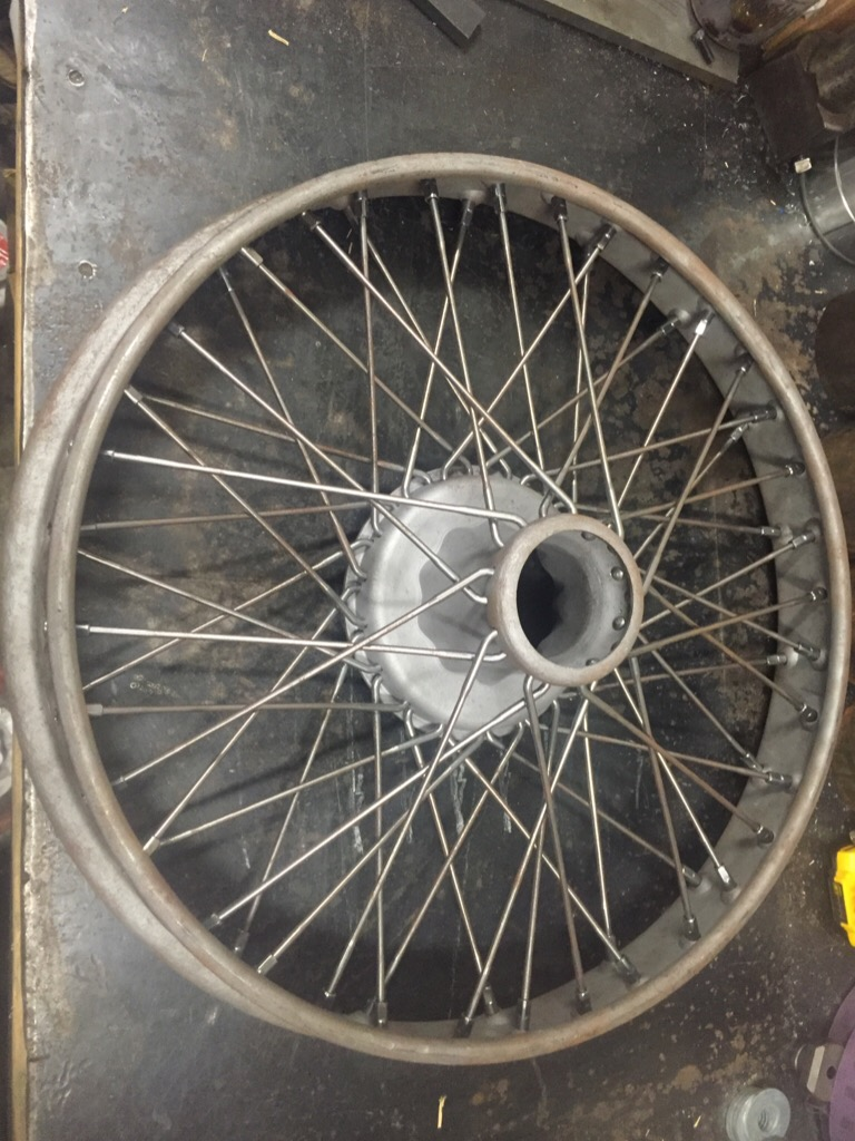 Model T Ford Forum: How to straighten twisted wire wheel rim ?