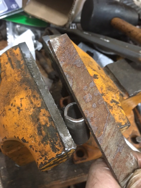 Filing the edge of the new bushing.