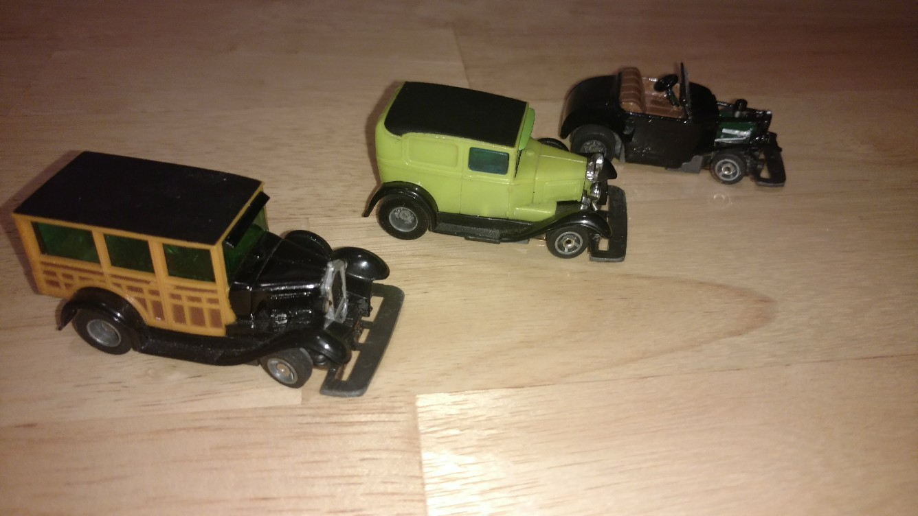 1920s-1930s - all three are Aurora bodies that used screws and I customized them to the slotless chassis.  The hot rod was a beat-up coupe that I modified.