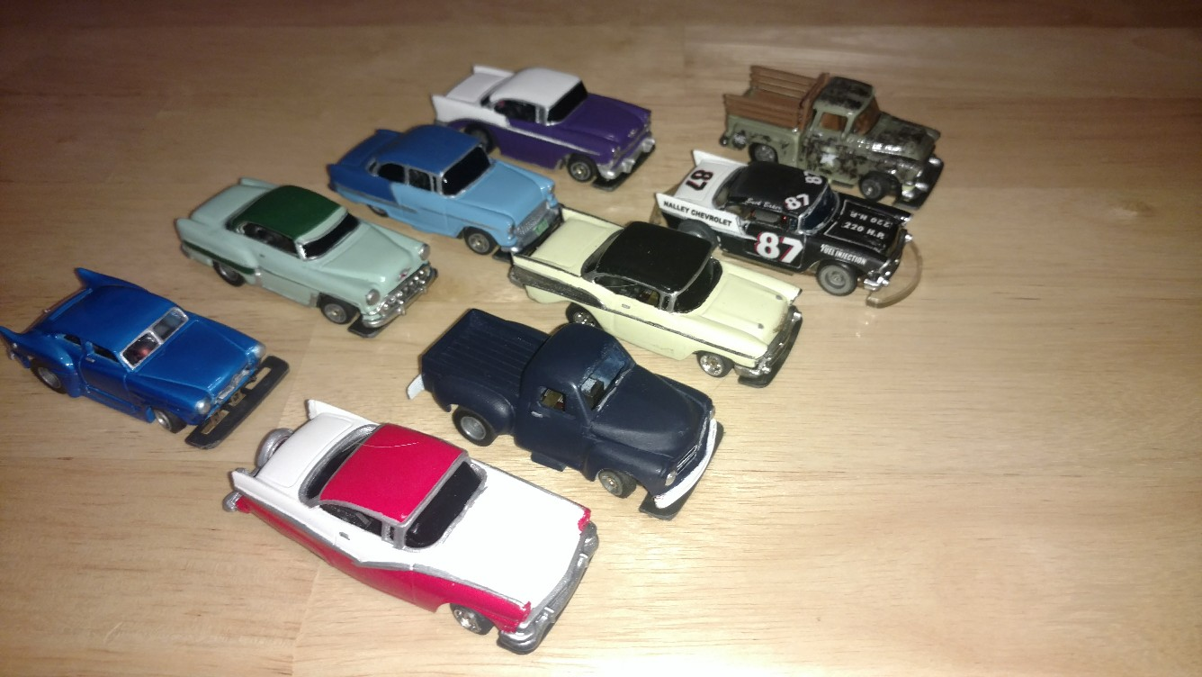 1950s - row two, the red/white car is based on Jack Kirmse's car (for those of you who know Jack of Graham, WA).  The blue unfinished pick-up I cast in resin from an M2 Machines body; the stepside pickup is a plastic Matchbox body that I made the stakes for.
