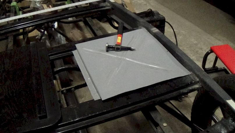 floor panel across from battery cover